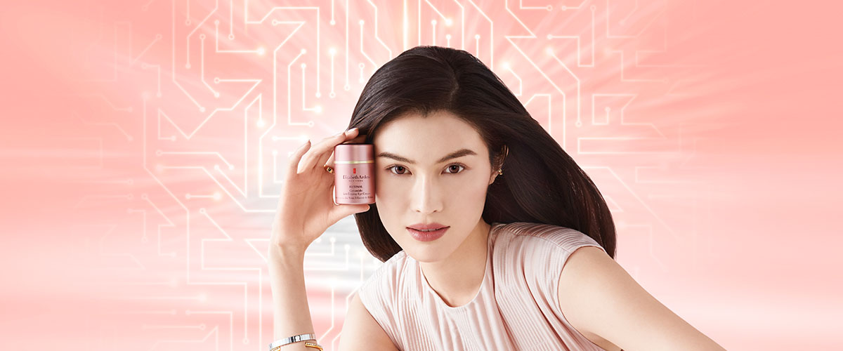 Model holding the Retinol Ceramide Line Erasing Eye Cream her face